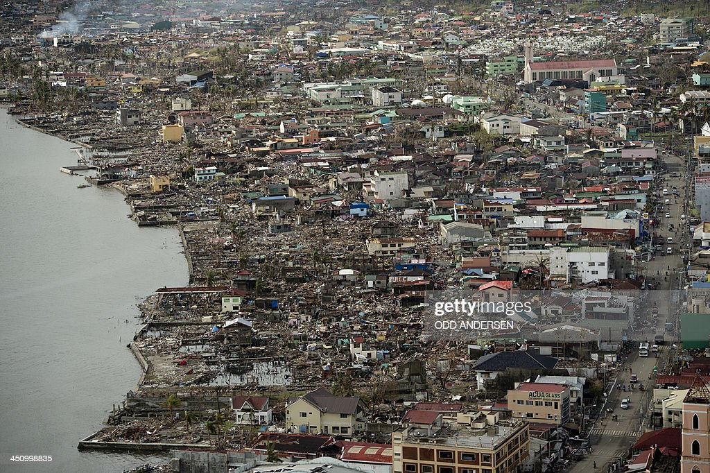 An aerial view shows the damage caused by Super Typhoon Haiyan to a seafront community nearly two weeks after the storm hit the Philippine city of...