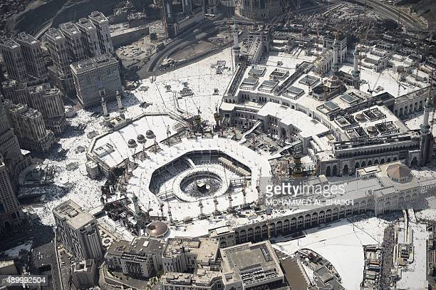 An aerial view shows the Grand mosque and Islam's holiest shrine the Kaaba in the holy Saudi city of Mecca on September 25 2015 AFP PHOTO / MOHAMMED...