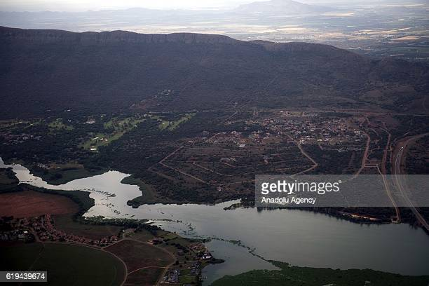 An aerial view shows the Hartbeespoort Dam region of North West South Africa on October 31 2016 Hartbeespoort Dam is an arch type dam situated in the...