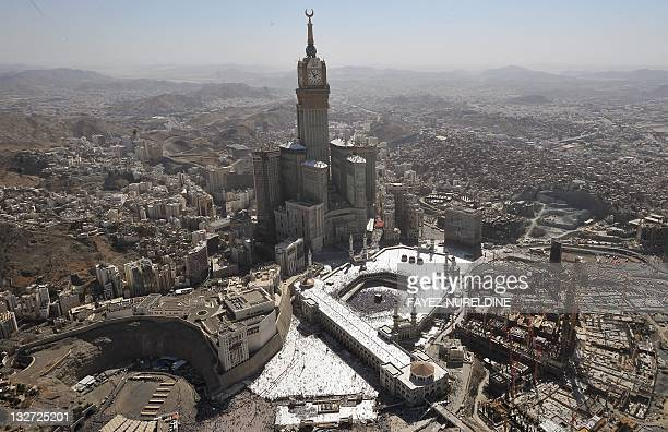 An aerial view shows the Mecca CLock Tower as Muslim pilgrims walking around the Kaaba in the Grand Mosque of the holy city of Mecca during the...