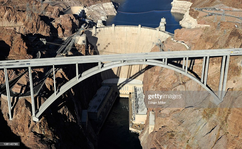 An aerial view shows the Mike O'Callaghan-Pat Tillman Memorial Bridge part of the Hoover Dam Bypass Project in front of the Hoover Dam October 26, 2010 in the Lake Mead National Recreation Area, Nevada. The 1,900-foot-long structure sits 890 feet above the Colorado River, about a quarter of a mile downstream from the Hoover Dam. The USD 240 million four-lane bypass project to relieve vehicle traffic on the Hoover Dam began in 2003, and opened to traffic on October 19.