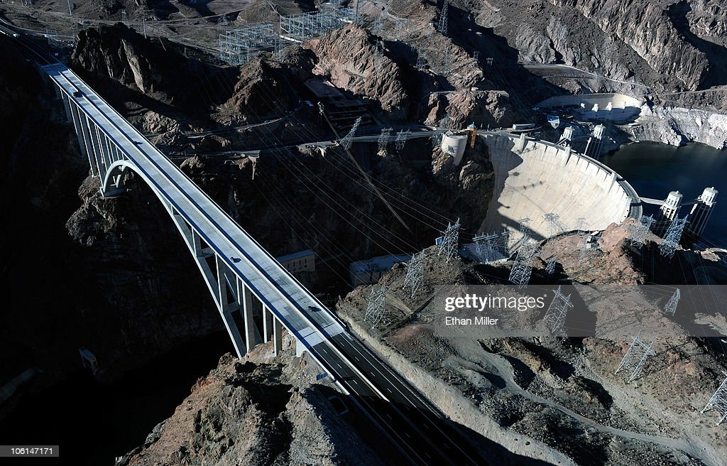 An aerial view shows the Mike O'Callaghan-Pat Tillman Memorial Bridge part of the Hoover Dam Bypass Project left of the Hoover Dam October 26, 2010 in the Lake Mead National Recreation Area, Nevada. The 1,900-foot-long structure sits 890 feet above the Colorado River, about a quarter of a mile downstream from the Hoover Dam. The USD 240 million four-lane bypass project to relieve vehicle traffic on the Hoover Dam began in 2003, and opened to traffic on October 19.