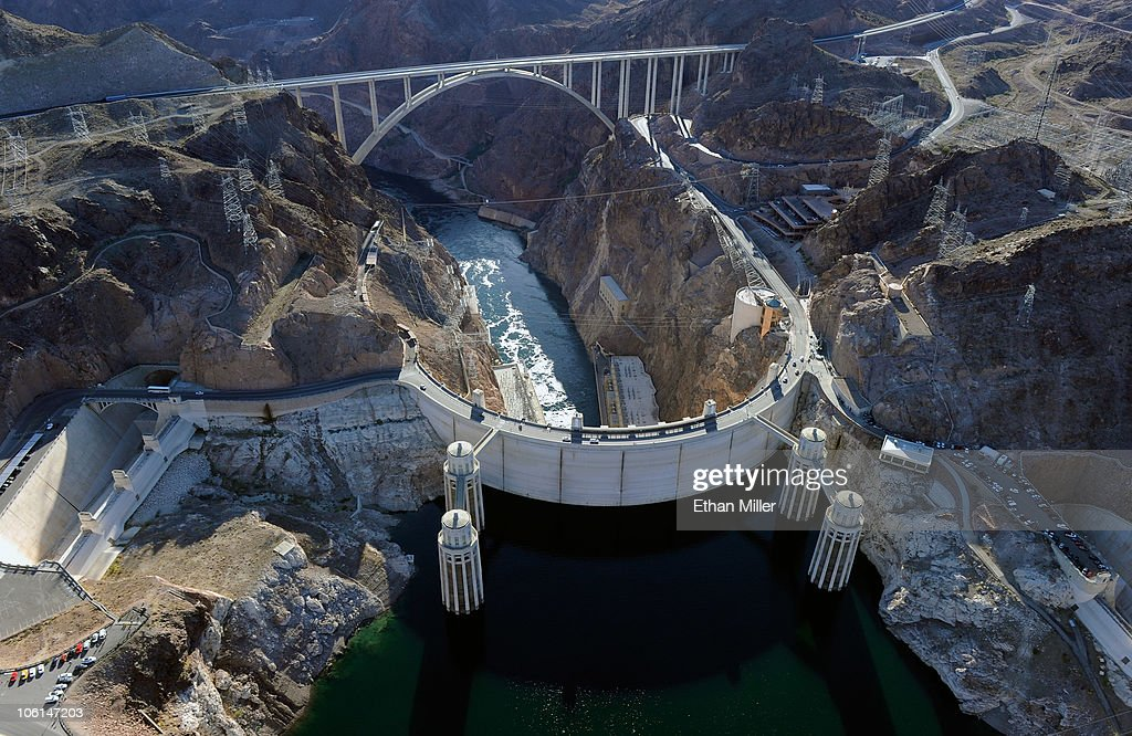 An aerial view shows the Mike O'Callaghan-Pat Tillman Memorial Bridge part of the Hoover Dam Bypass Project behind the Hoover Dam October 26, 2010 in the Lake Mead National Recreation Area, Nevada. The 1,900-foot-long structure sits 890 feet above the Colorado River, about a quarter of a mile downstream from the Hoover Dam. The USD 240 million four-lane bypass project to relieve vehicle traffic on the Hoover Dam began in 2003, and opened to traffic on October 19.