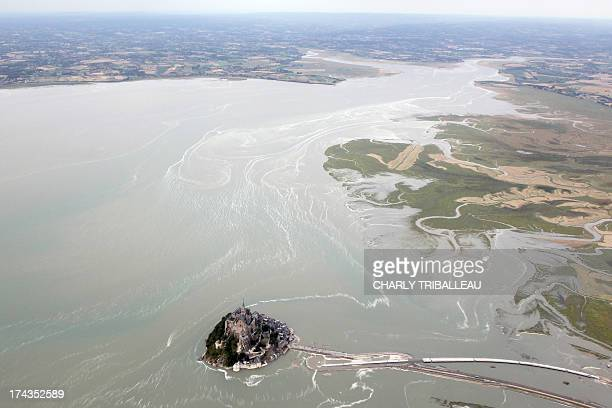 An aerial view shows the Mont SaintMichel northwestern France at high tide on July 24 2013 AFP PHOTO CHARLY TRIBALLEAU