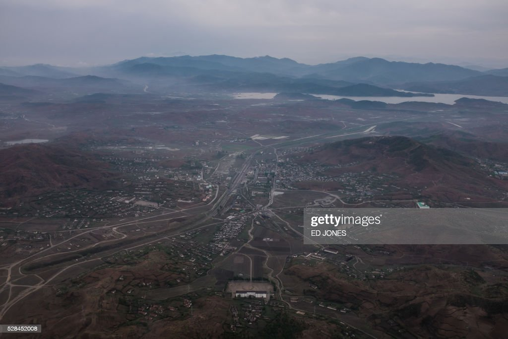 An aerial view shows the North Korean countryside from the window of an Air Koryo aircraft on approach to Pyongyang on May 5, 2016. North Korea readied to kick off its most important ruling party gathering for nearly 40 years, amid persistent concerns of a nuclear test, despite no clear signs of an imminent detonation. / AFP / Ed Jones