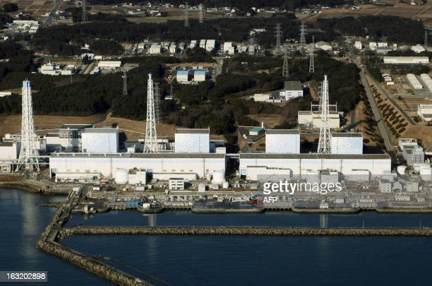 An aerial view shows the quakedamaged Fukushima nuclear power plant in the Japanese town of Futaba Fukushima prefecture on March 12 2011 Japan...