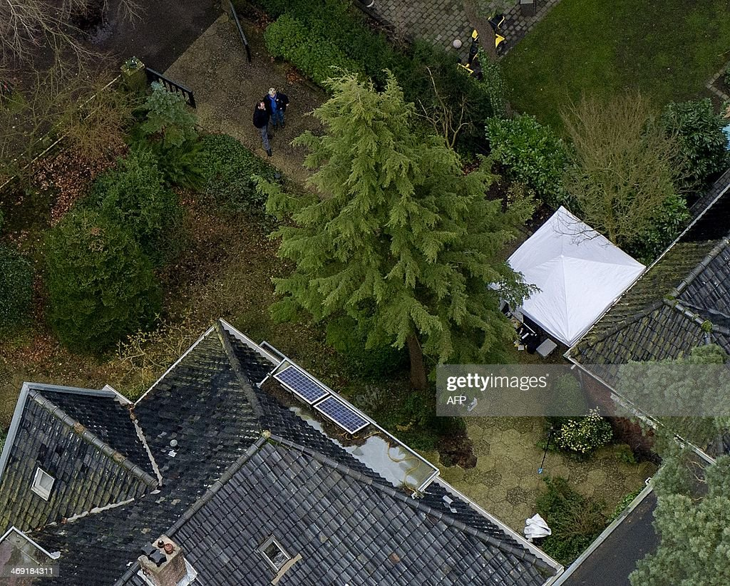 An aerial view shows the residence of late former Dutch health minister Els Borst, in Bilthoven on February 13, 2014, during a police investigation. Borst, who helped introduce the world's first euthanasia law in 2002 and who was found dead in her garage on February 10, 2014, was 'likely killed', police said.