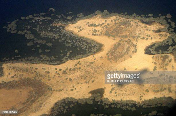An aerial view shows the shadow of a plane on a small island in the Nile River in Aswan 800 kms south of Cairo on September 25 2008 Bandits who...