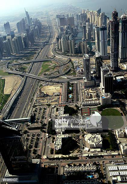 An aerial view shows the Sheikh Zayed road in the Gulf emirate of Dubai on December 17 2009 Dubai faces financial difficulties due to debts estimated...