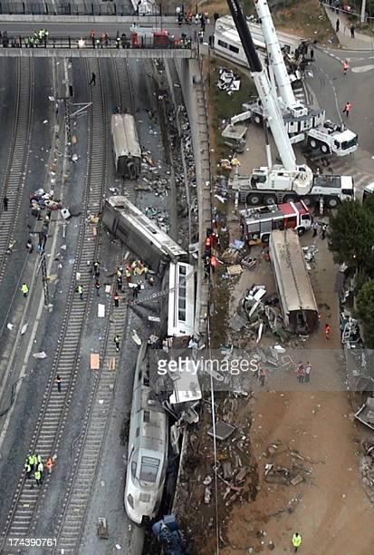 An aerial view shows the site of a train accident near the city of Santiago de Compostela on July 25 2013 A train hurtled off the tracks on July 24...