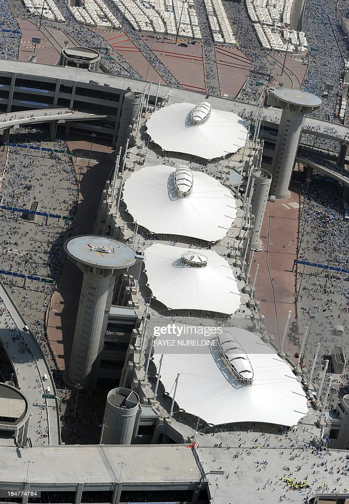 An aerial view shows the tents covering the pillars which pilgrims throw stones at on the 2nd day of 'Jamarat' ritual, the stoning of Satan, in Mina near the holy city of Mecca, on October 16, 2013. Pilgrims pelt pillars symbolising the devil with pebbles to show their defiance on the third day of the hajj as Muslims worldwide mark the Eid al-Adha or the Feast of the Sacrifice, marking the end of the hajj pilgrimage to Mecca and commemorating Abraham's willingness to sacrifice his son Ismail on God's command in the holy City of Mecca.