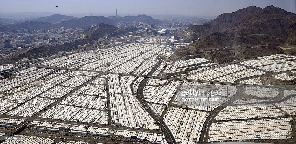 An aerial view shows thousands of tents hosting pilgrims in Mina near the holy city of Mecca, on October 16, 2013. Saudi Arabia said that around 1.98 million pilgrims are performing this year's annual Muslim pilgrimage, the hajj, sharply fewer than last year due to reduced quotas.