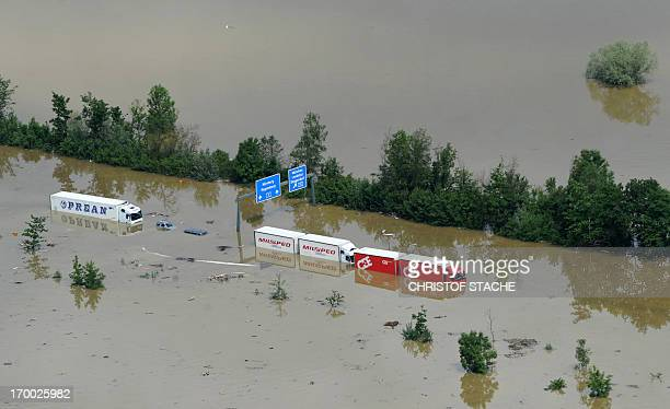 An aerial view shows Trucks and cars remaining under water on an flooded highway near the Bavarian village of Deggendorf southern Germany on June 6...