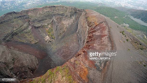 An aerial view taken from an helicopter window shows the crater of the mount Vesuvius volcano is seen near the Italian city of Naples on March 31...