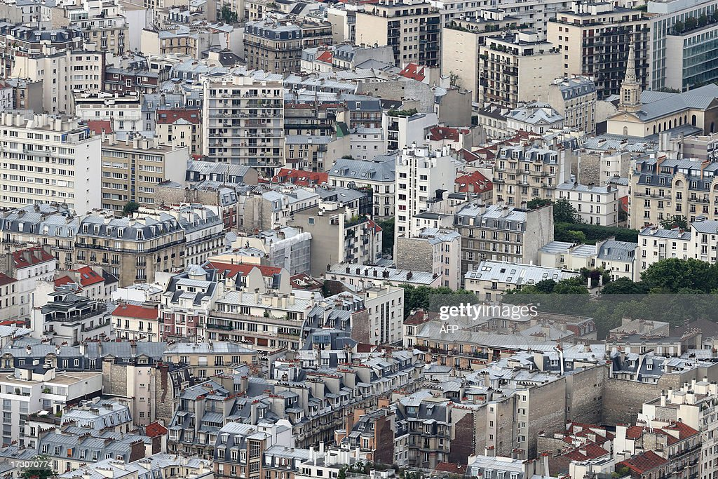 An aerial view taken from the Eiffel Tower on July 6, 2013 shows buildings in Paris. AFP PHOTO / THOMAS SAMSON