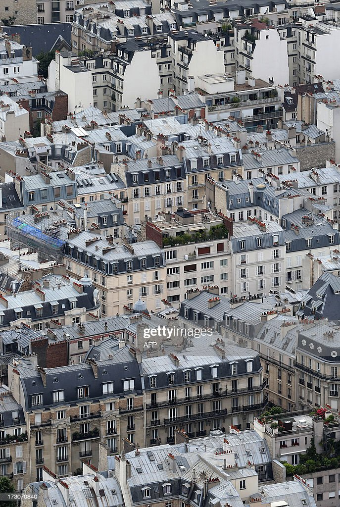 An aerial view taken from the Eiffel Tower on July 6, 2013 shows buildings in Paris.