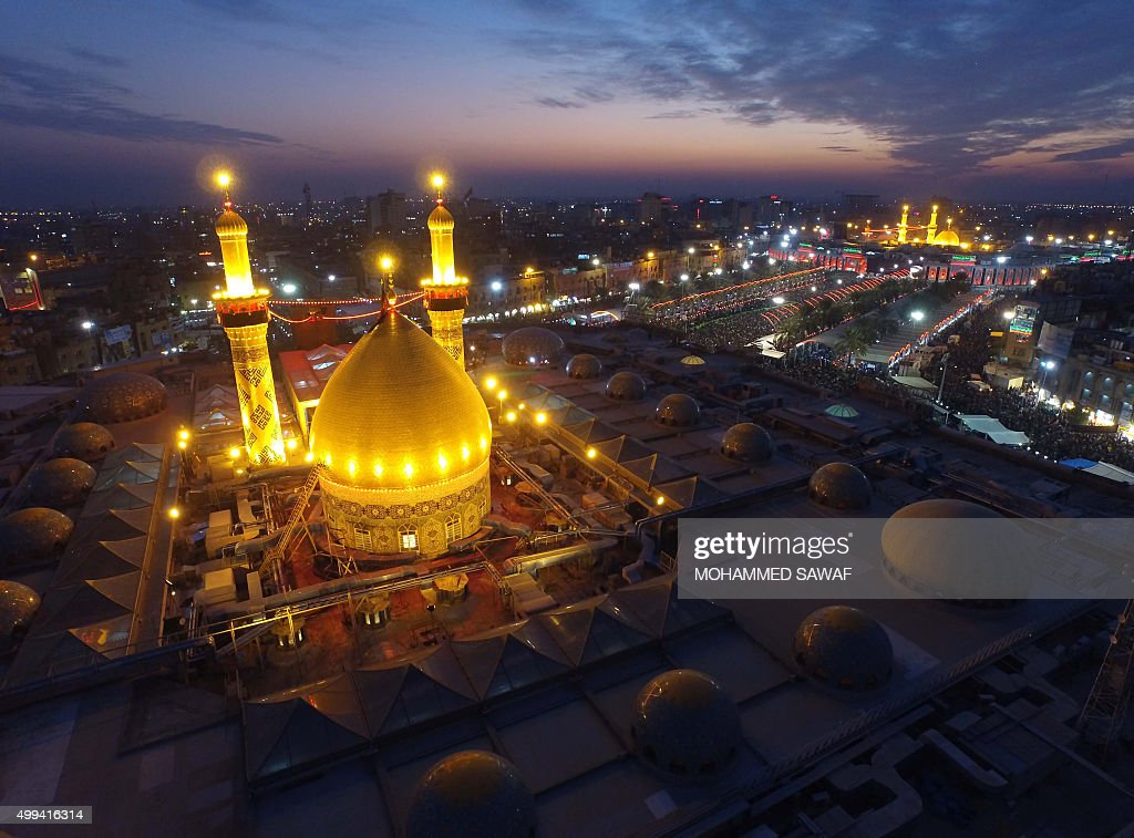 TOPSHOT An aerial view taken on December 1 2015 shows Iraqi Shiite pilgrims gathering at the shrines of Immam Abbas ibn Ali and Imam Hussein during...
