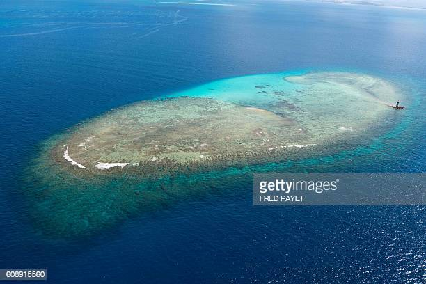 An aerial view taken on February 27 2016 shows coral reefs part of the UNESCOlisted World Heritage Area in New Caledonia in the south Pacific...