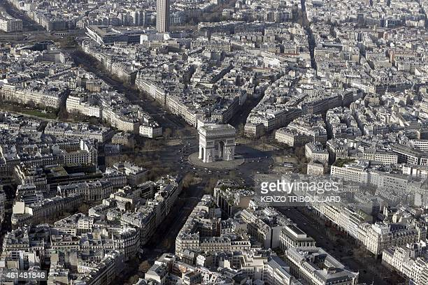 An aerial view taken on January 11 2015 shows the Arc de Triomphe in Paris AFP PHOTO / KENZO TRIBOUILLARD
