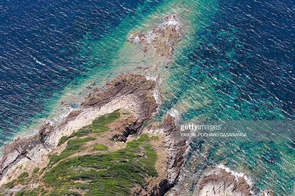 An aerial view taken on July 01, 2013, shows a part of the coast close to Cargese on the French mediterranean Island of Corsica.