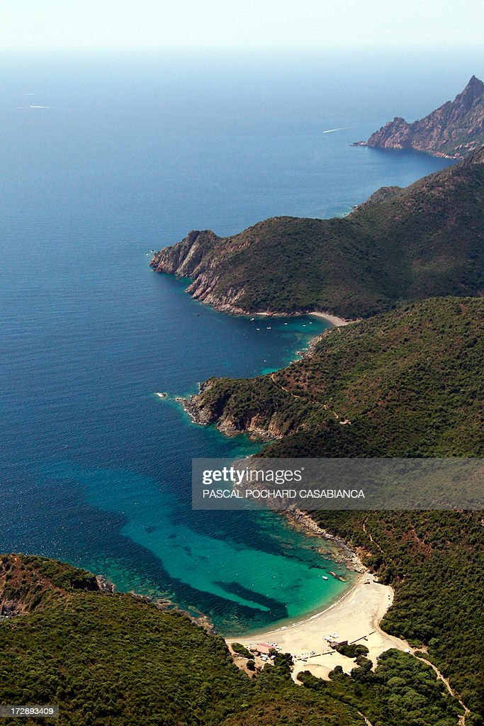 An aerial view taken on July 1, 2013, shows the coast close from Porto, in the natural reserve of Scandola, French Mediterranean Island of Corsica.