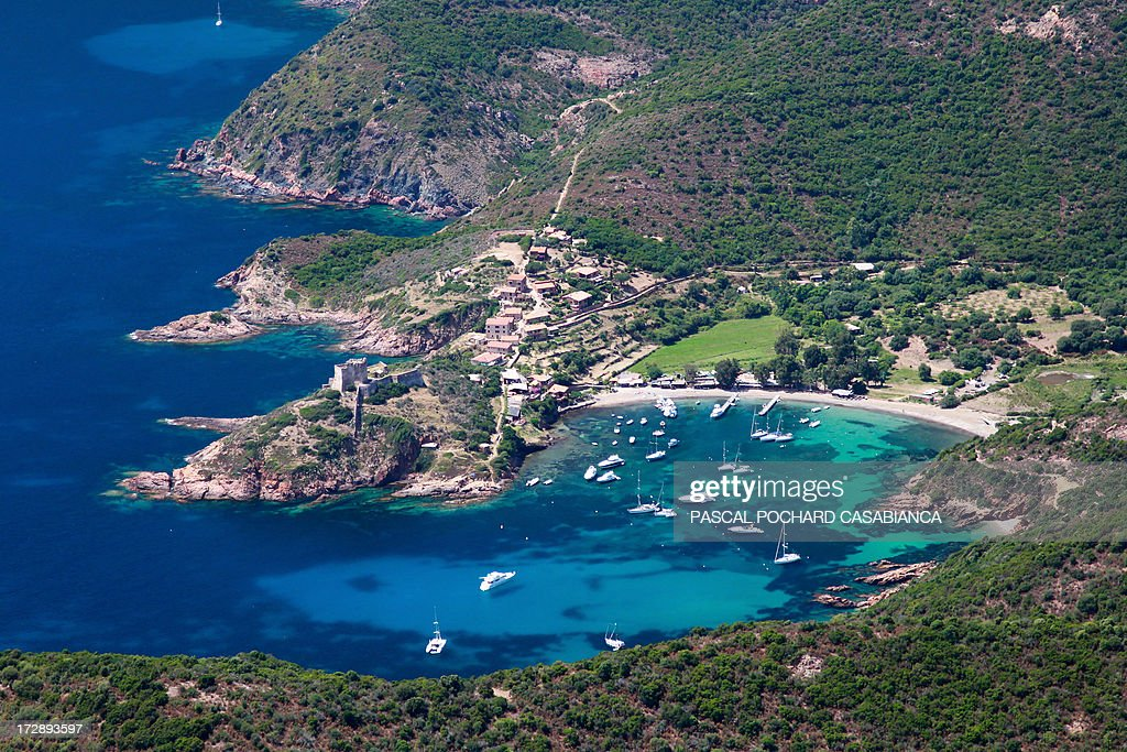 An aerial view taken on July 1, 2013, shows the port of Girolata Osani, in the natural reserve of Scandola, on the French Mediterranean Island of Corsica.