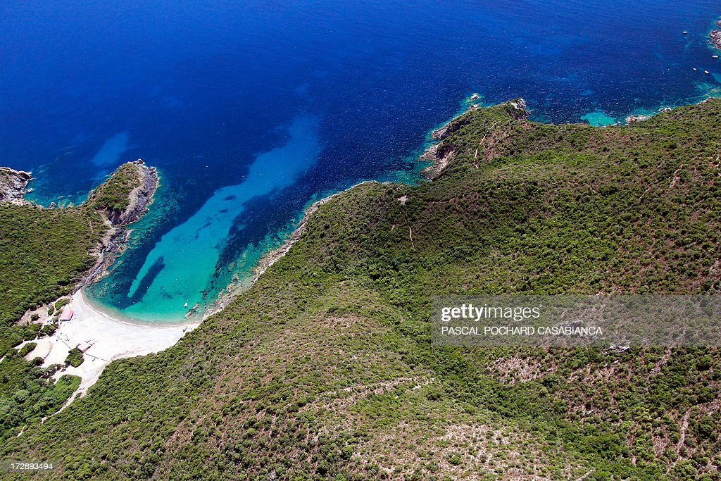 An aerial view taken on July 1r, 2013, shows the coast close from Porto, in the natural reserve of Scandola on the French Mediterranean Island of Corsica.