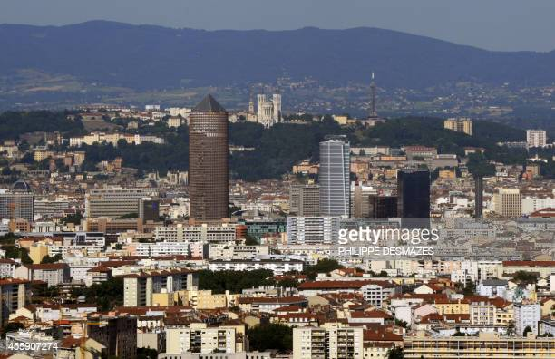 An aerial view taken on July 31 shows a partial view of Lyon southeastern France Center is La PartDieu and Oxygene office towers with at background...