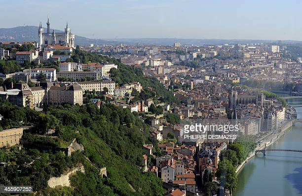 An aerial view taken on July 31 shows the historical district of the southeastern French city of Lyon the 'Fourviere' hill with the basilica...