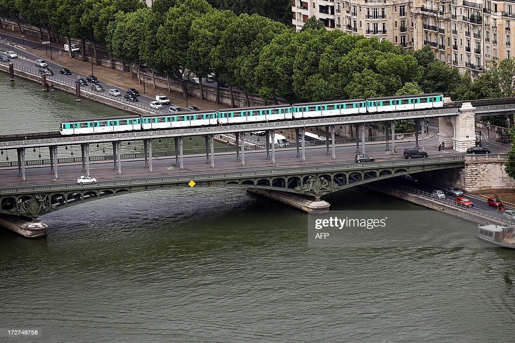 An aerial view taken on July 4, 2013 shows a subway train on the Bir Hakem bridge in Paris. AFP PHOTO / THOMAS SAMSON