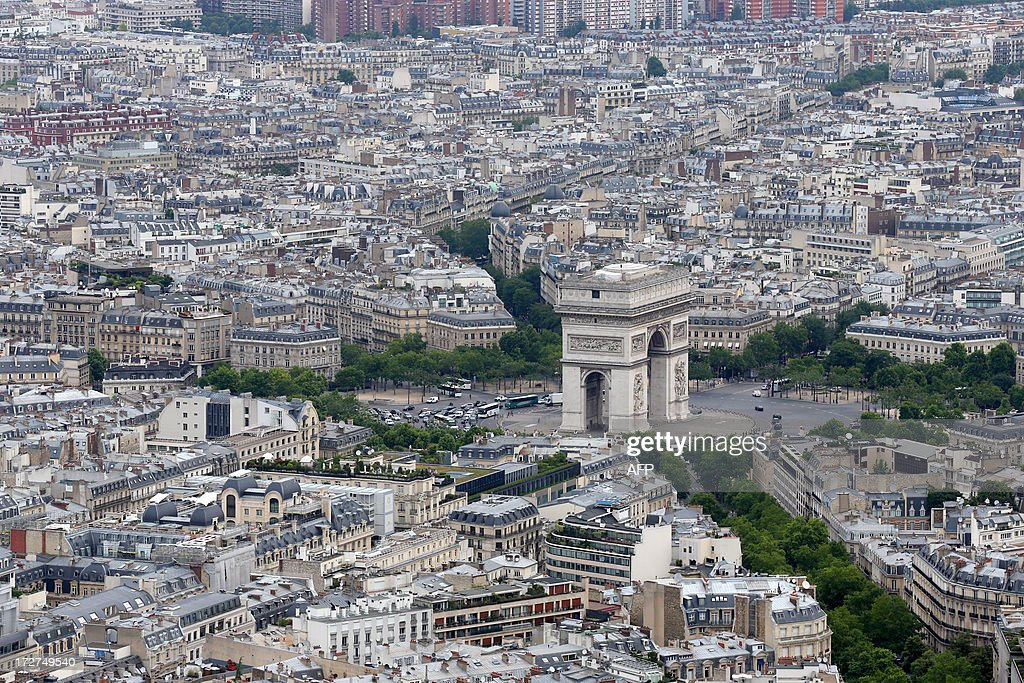 An aerial view taken on July 4, 2013 shows the Arc de Triomphe in Paris. AFP PHOTO / THOMAS SAMSON