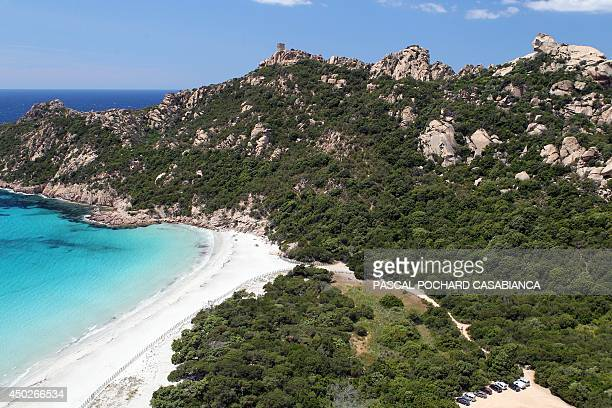 An aerial view taken on June 1 2014 on the French Mediterranean island of Corsica shows the Roccapina beach with the 'Lion's rock' close to Sartene...
