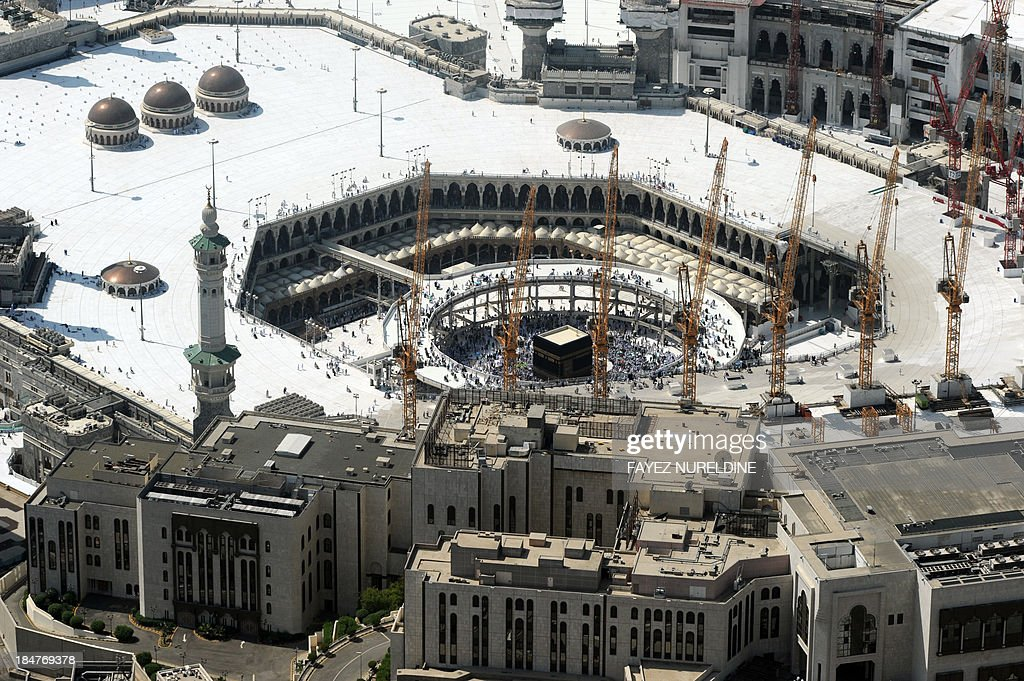 An aerial view taken on October 16, 2013 shows the Grand mosque and the Kaaba in the holy city of Mecca. Pilgrims pelt pillars symbolising the devil with pebbles to show their defiance on the third day of the hajj as Muslims worldwide mark the Eid al-Adha or the Feast of the Sacrifice, marking the end of the hajj pilgrimage to Mecca and commemorating Abraham's willingness to sacrifice his son Ismail on God's command in the holy City of Mecca. AFP PHOTO/FAYEZ NURELDINE