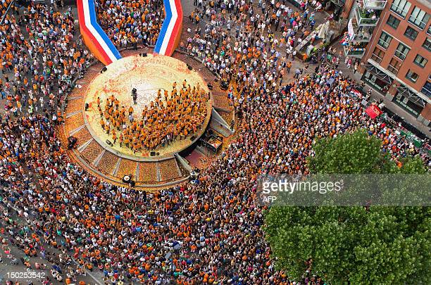 An aerial view taken using an Octocopter a remote controlled helicopter shows the ceremony honouring the Dutch Olympic team in Den Bosch the...