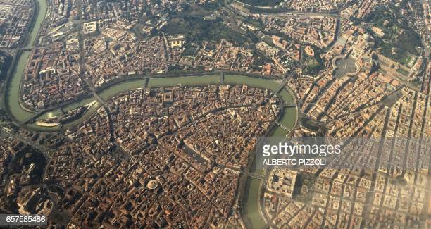 An aerial view taken with a mobile phone shows the city of Rome on March 25 2017 Italian capital hosts a special summit of European leaders today to...