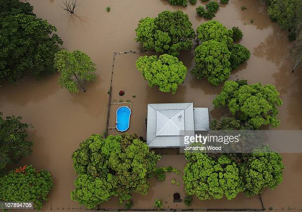 An aeriel view of a suburban home and backyard swimming pool on January 6 2011 in Rockhampton Australia Floodwaters peaked at 92 metres yesterday in...