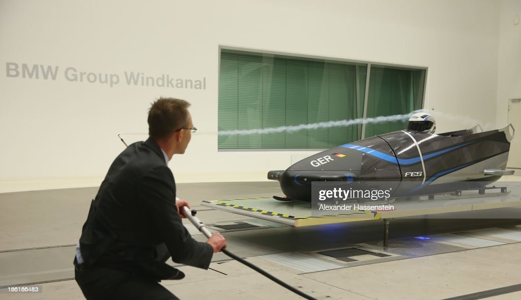 An aerodynamicist controls the aerodynamics of the new Bobsleigh FES 208 piloted by Francesco Friedrich and Alexander Mann of Team Germany 1 in the Wind tunnel of Technology Partner BMW on October 29, 2013 in Munich, Germany.
