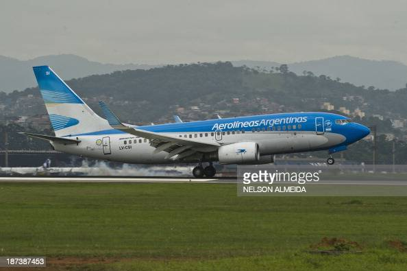 An Aerolineas Argentinas airliner lands at Sao Paulo International Airport in Guarulhos Brazil on November 8 2013 AFP PHOTO / Nelson ALMEIDA