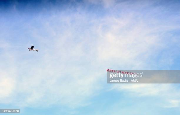 An aeroplane fly's over the Bet365 Stadium with a banner saying 'Wenger out means out' during the Premier League match between Stoke City and Arsenal...