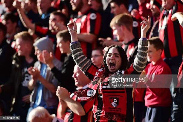 An AFC Bournemouth fan celebrates during the Barclays Premier League match between AFC Bournemouth and Tottenham Hotspur at Vitality Stadium on...