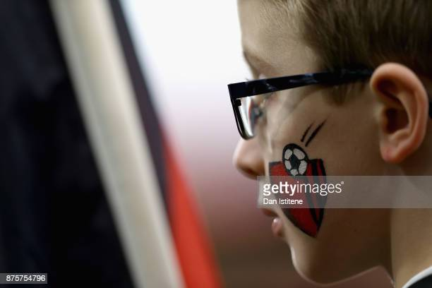 An AFC Bournemouth supporter is seen prior to the Premier League match between AFC Bournemouth and Huddersfield Town at Vitality Stadium on November...