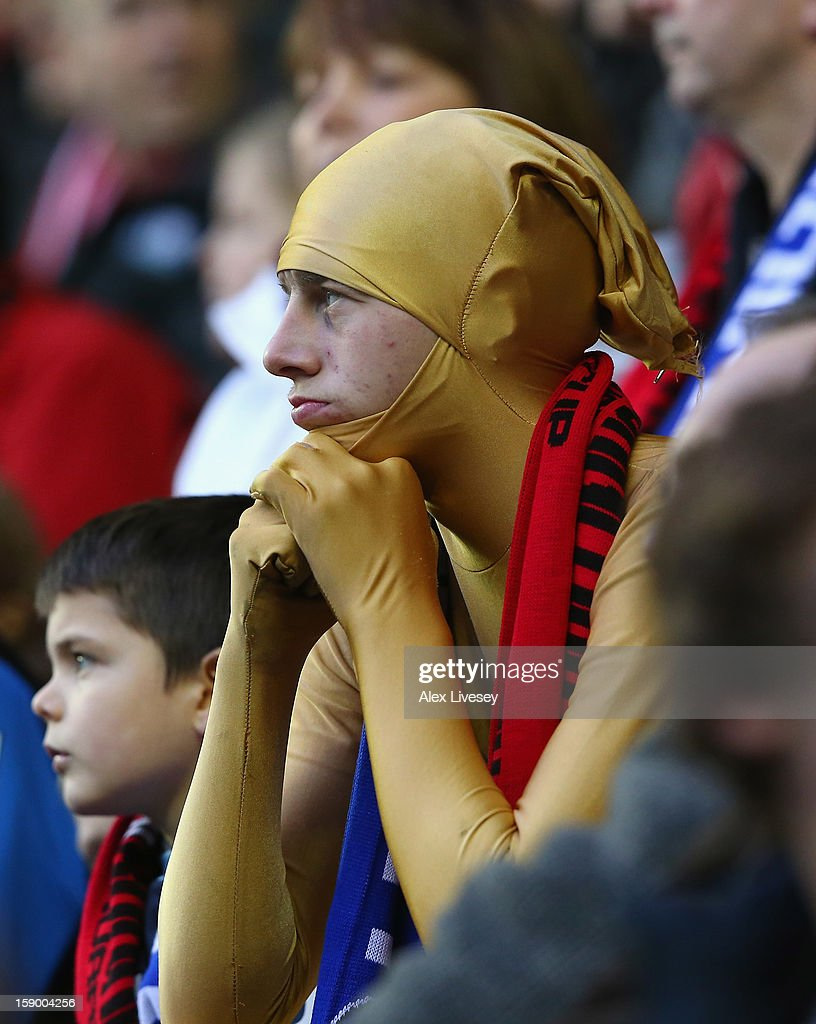 An AFC Bournemouth supporter looks on during the Budweiser FA Cup Third Round match between Wigan Athletic and AFC Bournemouth at DW Stadium on January 5, 2013 in Wigan, England.