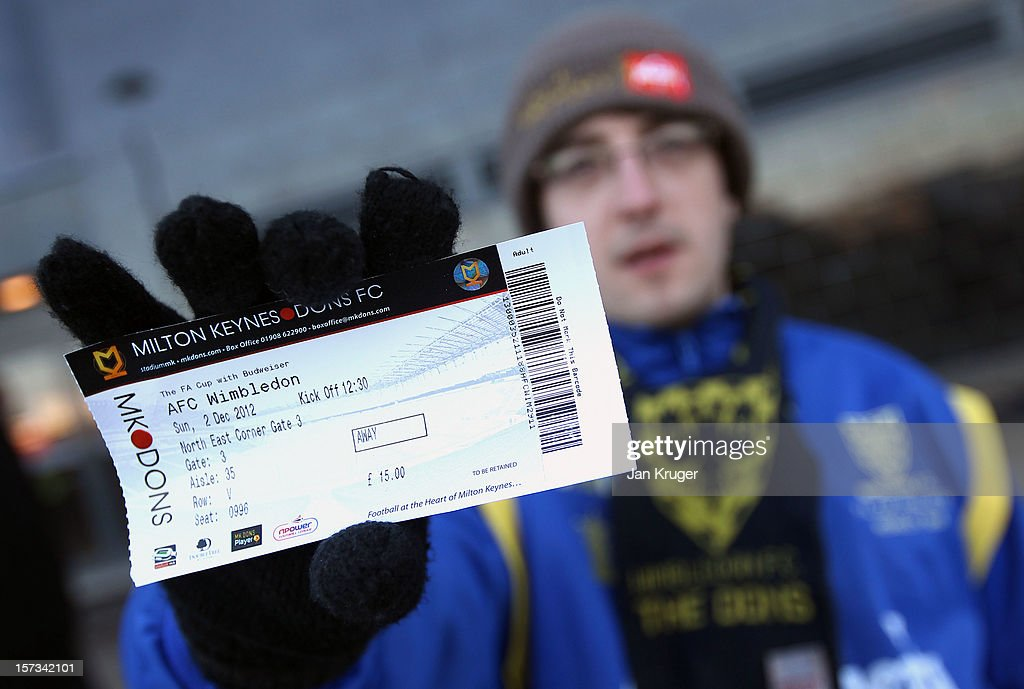 An AFC Wimbledon fan show his ticket prior to the FA Cup with Budweiser Second Round match between MK Dons and AFC Wimbledon at StadiumMK on December 2, 2012 in Milton Keynes, England. This match is the first meeting between the two teams following the formation of AFC Wimbledon (the football club formed in 2002 by supporters unhappy with their club's relocation to Milton Keynes) and the MK Dons (which Wimbledon F.C. controversially became).