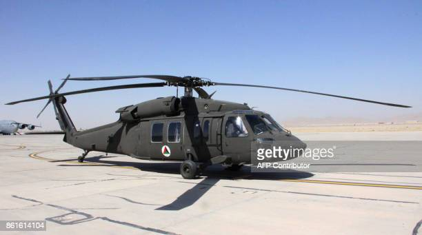 An Afghan air force UH60 Black Hawk helicopter sits at Kandahar Airfield in Afghanistan on September 28 2017 Parked at a military runway in...