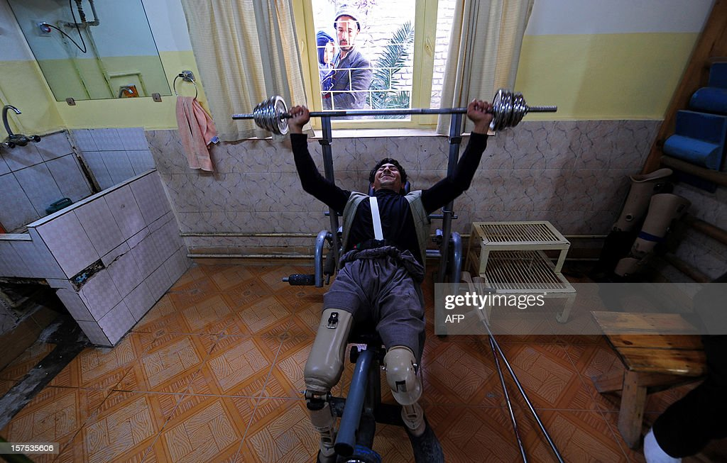 An Afghan amputee lifts weights at the International Committee of the Red Cross (ICRC) hospital for war victims and the disabled in Mazar-i Sharif on December 4, 2012. The ICRC Orthopaedic Project, which began in 1988 in Kabul, now has seven centres in various Afghan provinces.