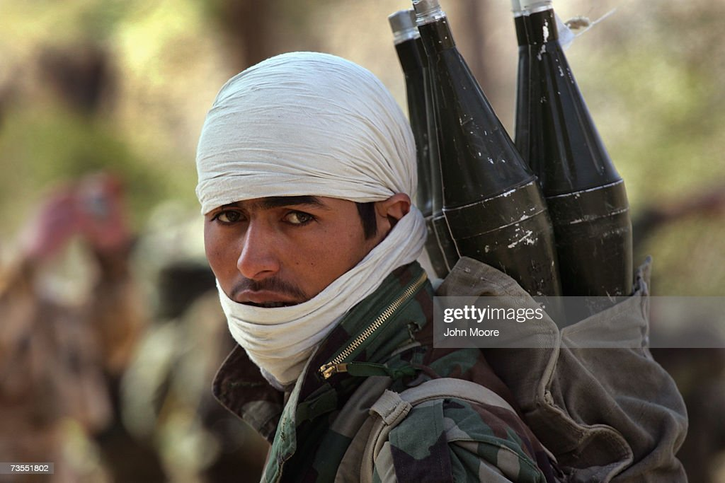 An Afghan Army soldier carrying rocketpropelled grenades arrives with fellow Afghan and UK forces to Kajaki on March 12 2007 in Southern Helmand...