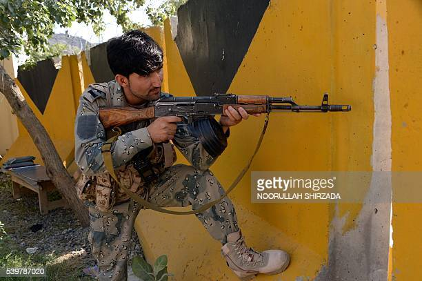 An Afghan border policeman takes position after overnight clashes with Pakistani forces on the border between Afghanistan and Pakistan in eastern...