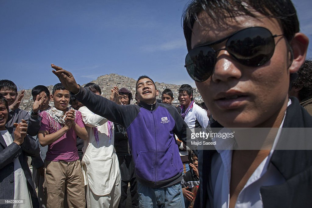 An Afghan boy dances during a celebrations near the Sakhi shrine, which is the centre of the Afghanistan new year celebrations during the Nowruz festivities on March 21, 2013 in Kabul, Afghanistan. Nowruz is an ancient festival which marks the beginning of the spring equinox and the start of the year in the Iranian calendar, which this coming year will be 1392.