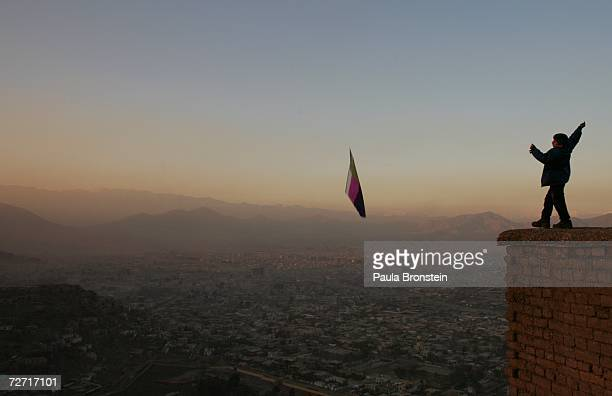 An Afghan boy flies a kite on top of a hill overlooking Kabul November 23 2006 in Kabul Afghanistan Kabul is now still in transition five years after...