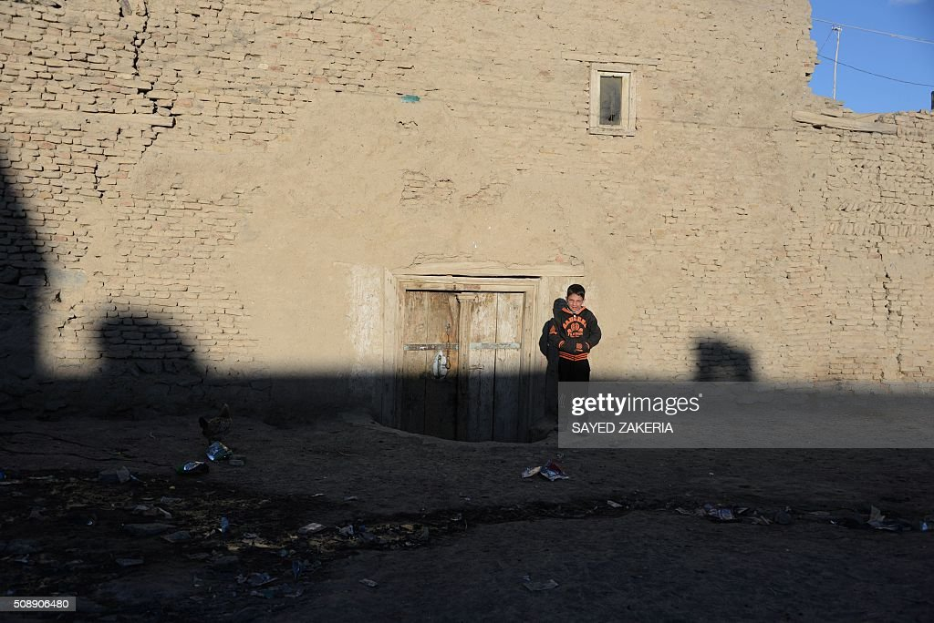 An Afghan boy looks on in the old section of Ghazni on February 7, 2016. AFP PHOTO / SAYED ZAKERIA / AFP / SAYED ZAKERIA